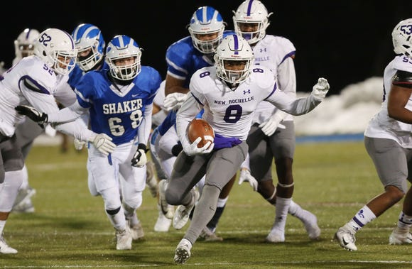 New Rochelle's Jordan Forrest (8) runs from the Shaker defense during the state Class AA semifinal game at Middletown High School Nov. 17, 2018.