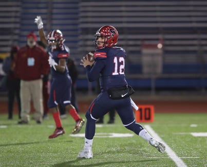 Stepinac's Joey Carino (12) looks for an open receiver down field during their 29-18 win over Cardinal Hayes in the CHSFL Class 'AA' Championship Game at Mitchel Field Complex in Uniondale on Saturday, November 17, 2018.