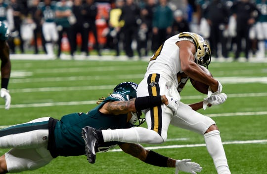 New Orleans Saints wide receiver Tre'Quan Smith pulls in a touchdown reception against Philadelphia Eagles cornerback Cre'von LeBlanc in the first half of an NFL football game in New Orleans, Sunday, Nov. 18, 2018. (AP Photo/Bill Feig)