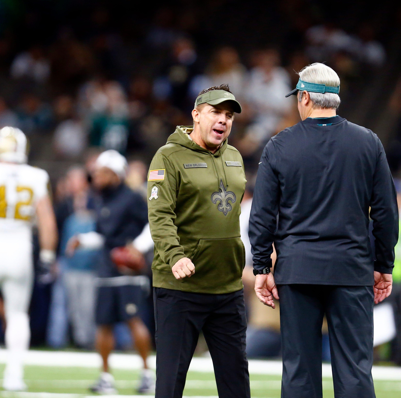 New Orleans Saints head coach Sean Payton, left, greets Philadelphia Eagles head coach Doug Pederson before an NFL football game in New Orleans, Sunday, Nov. 18, 2018. (AP Photo/Butch Dill)