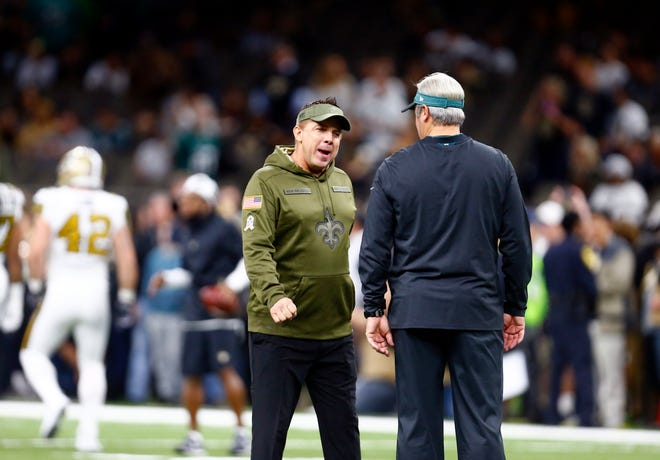 New Orleans Saints head coach Sean Payton, left, greets Philadelphia Eagles head coach Doug Pederson before an NFL football game in New Orleans, Sunday, Nov. 18, 2018. (AP Photo/Butch Dill)