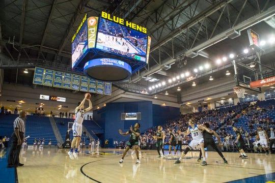 Delaware's Matt Veretto (32) shoots a three-pointer Sunday against Wilmington University. Delaware defeated Wilmington University at the Bob Carpenter Center 70-40.