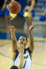 Delaware's Kevin Anderson (1) shoots Sunday against Wilmington University. Delaware defeated Wilmington University at the Bob Carpenter Center 70-40.
