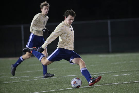 Salesianum senior Thomas McGrail sends the ball downfield in the first half.