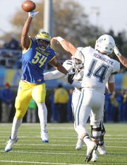 Delaware's Brandan Hall reaches for a pass thrown by Villanova's Zach Bednarczyk in the third quarter of the Blue Hens' 42-21 loss at Delaware Stadium Saturday.