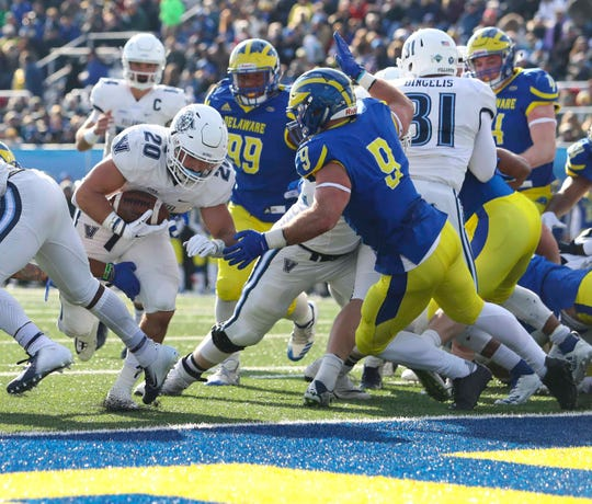 Villanova running back Matt Gudzak gets in the end zone before Delaware's Troy Reeder can stop him in the second quarter at Delaware Stadium in 2018.