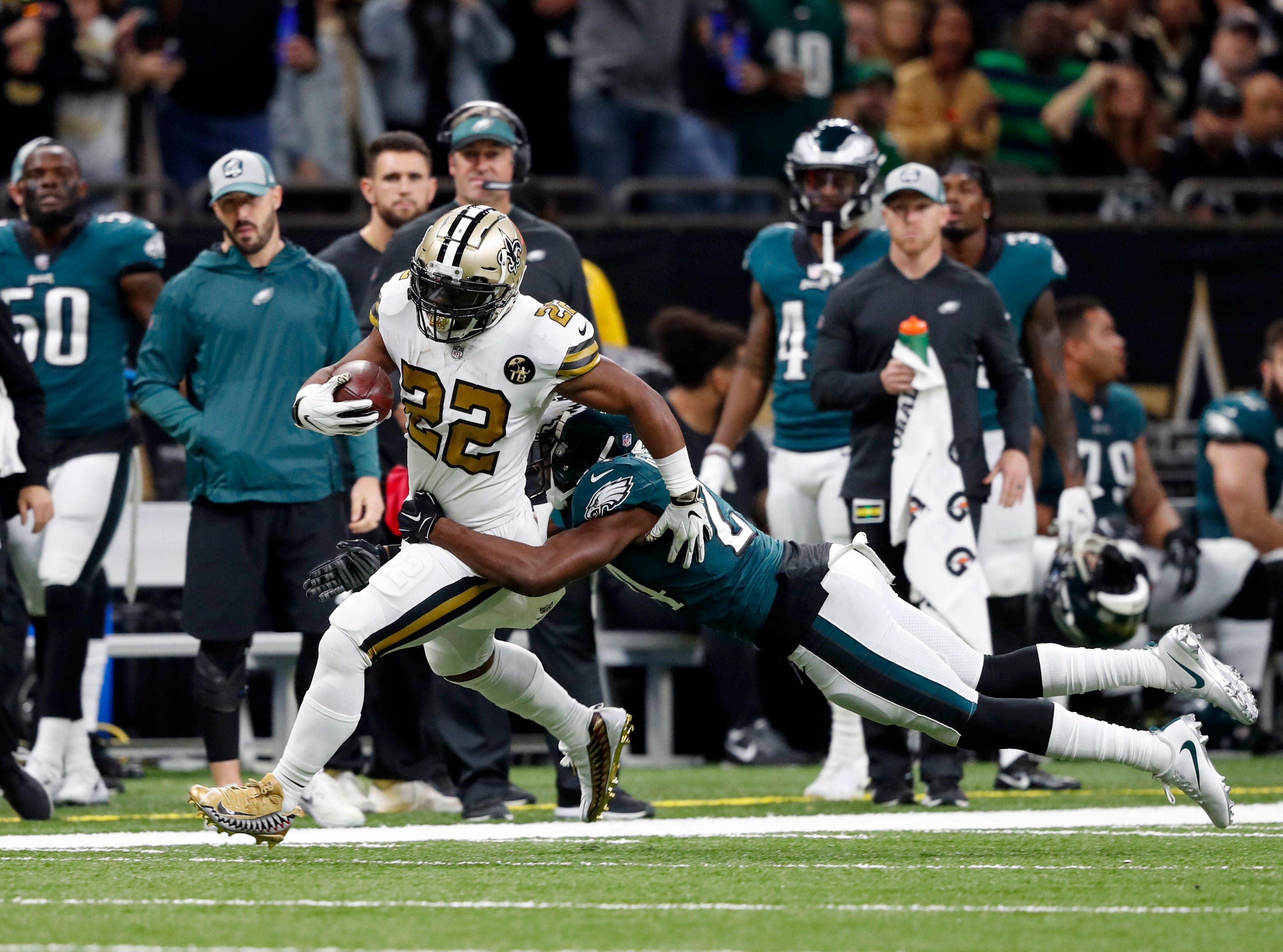 New Orleans Saints running back Mark Ingram (22) carries as Philadelphia Eagles free safety Corey Graham (24) tackles in the first half of an NFL football game in New Orleans, Sunday, Nov. 18, 2018. (AP Photo/Gerald Herbert)