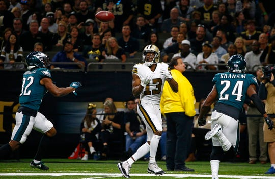 New Orleans Saints wide receiver Michael Thomas (13) pulls in a touchdown reception between Philadelphia Eagles cornerback Rasul Douglas (32) and free safety Corey Graham (24) in the second half of an NFL football game in New Orleans, Sunday, Nov. 18, 2018. (AP Photo/Butch Dill)