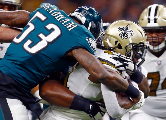 Philadelphia Eagles outside linebacker Nigel Bradham (53) tries to tackle New Orleans Saints running back Alvin Kamara in the first half of an NFL football game in New Orleans, Sunday, Nov. 18, 2018. (AP Photo/Butch Dill)