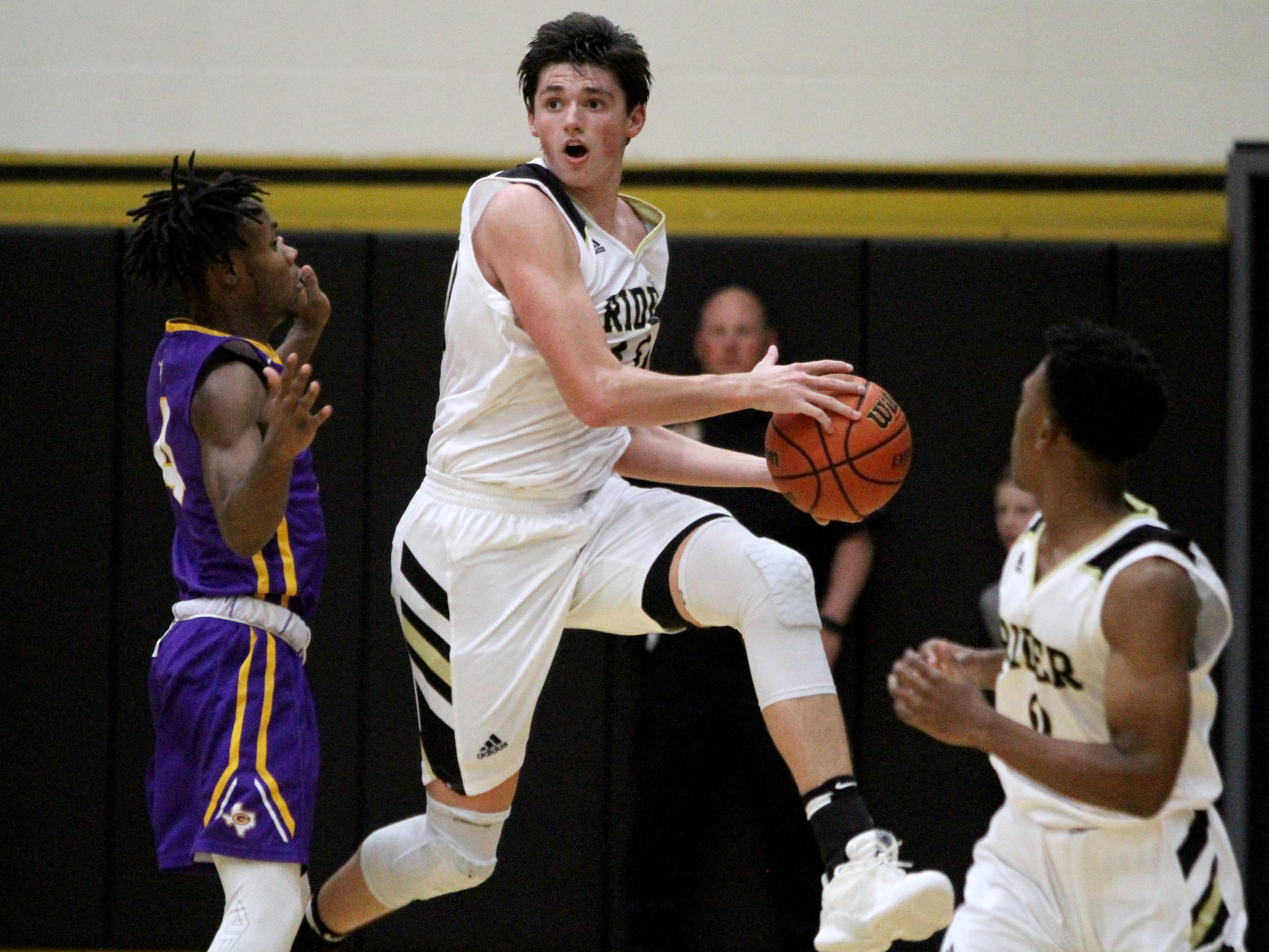 Rider's Ty Caswell throws the ball toward the basket at the end of the half of the game against Granbury Saturday, Nov. 17, 2018, at Rider.