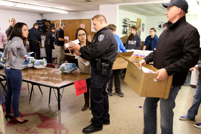 The Wichita Falls Police Officers Association worked Sunday to put together and deliver about 80 Thanksgiving baskets at the WFPOA building.