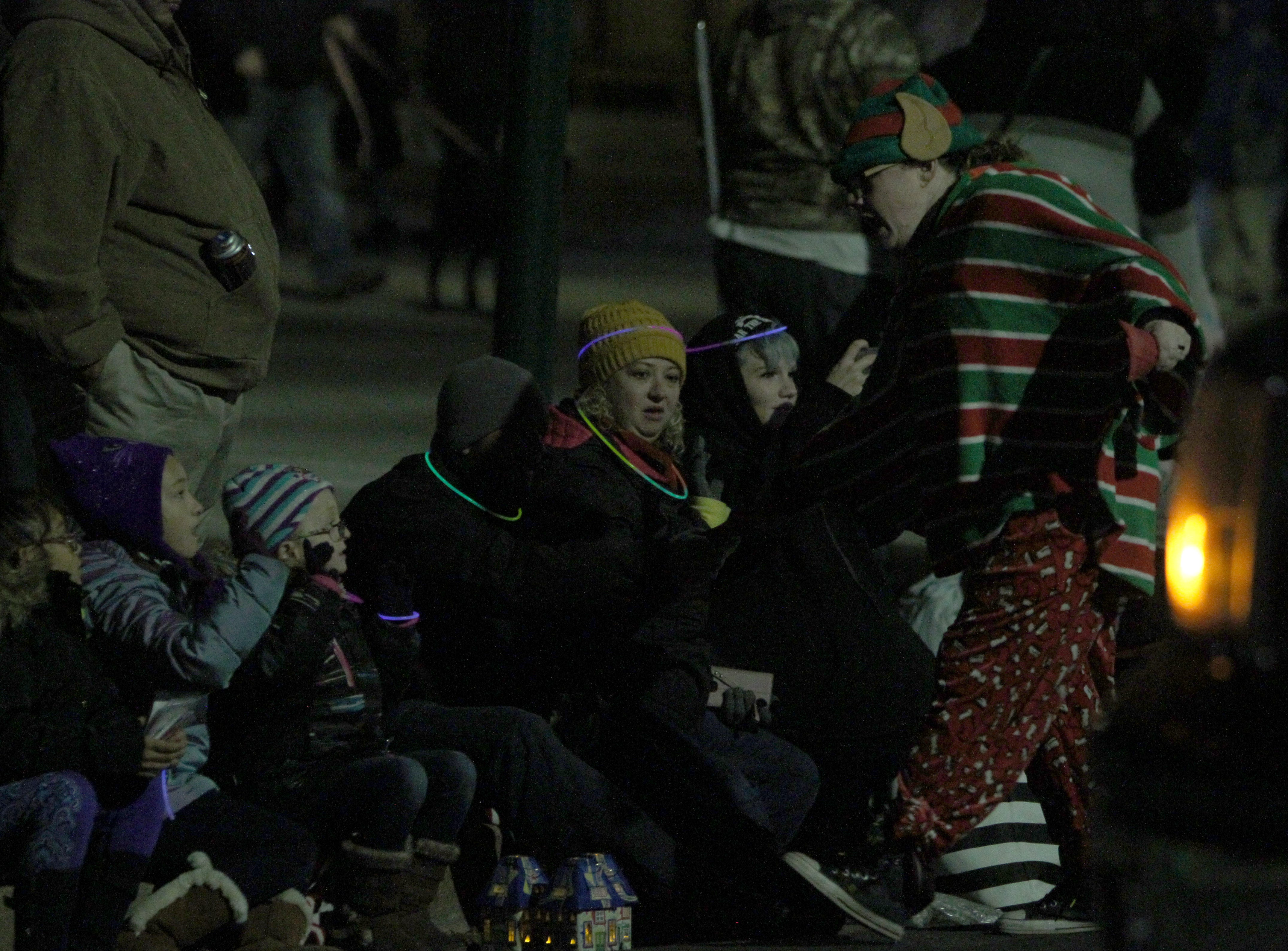 People stay warm as they watch the Wichita Falls City Lights Parade Saturday, Nov. 17, 2018, downtown.