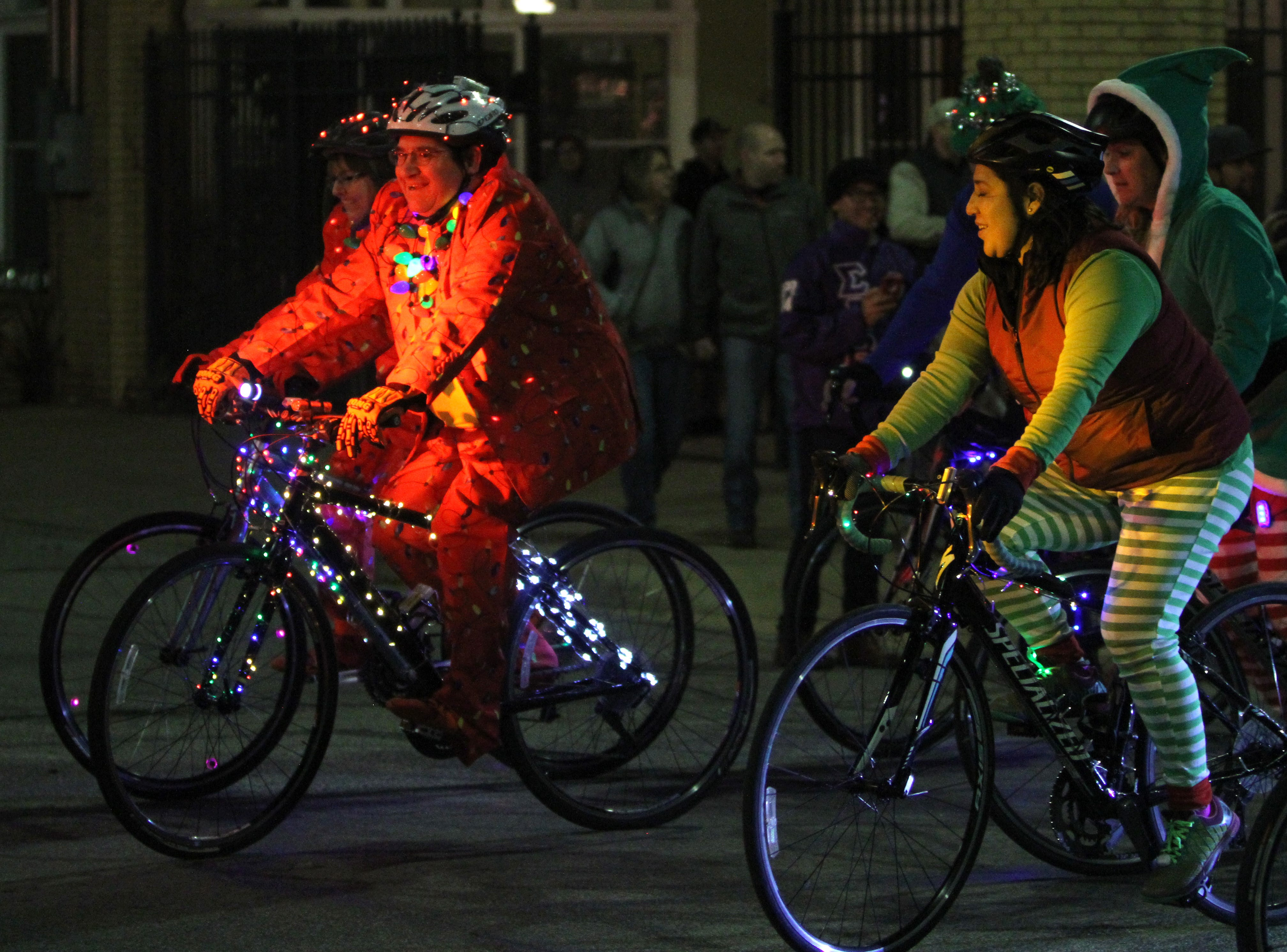 People ride bikes in the Wichita Falls City Lights Parade Saturday, Nov. 17, 2018, downtown.