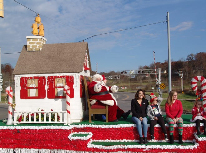 Santa and Mrs. Claus officially ushered in the holiday season as they rode into town during the recent annual parade in South Zanesville.
