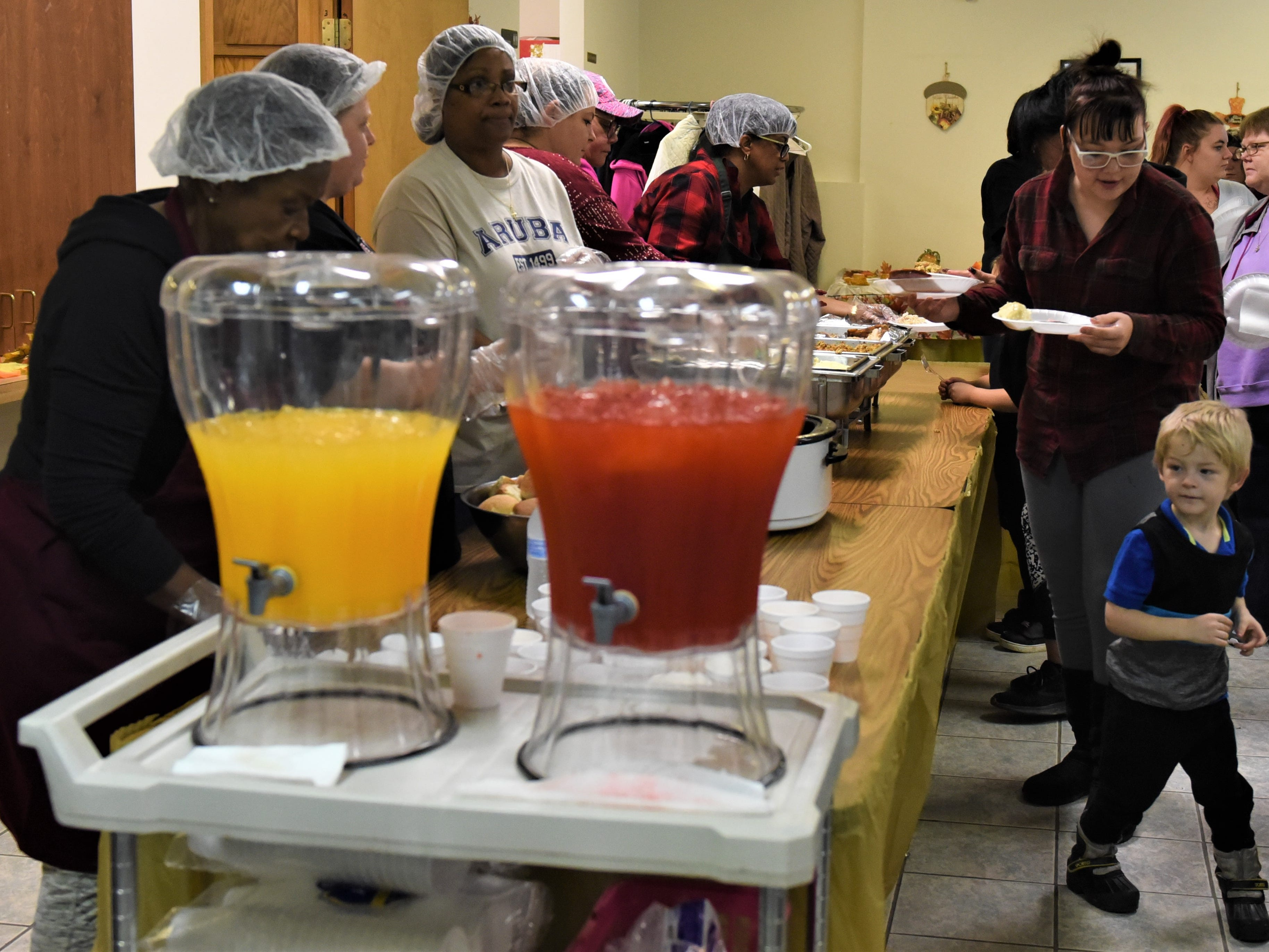 People are served during the annual Thanksgiving dinner at St. Paul AME Church on Pine Street in Zanesville. The event has been held annually for more than a decade on the Saturday before the holiday. The church prepares food for 125 people.