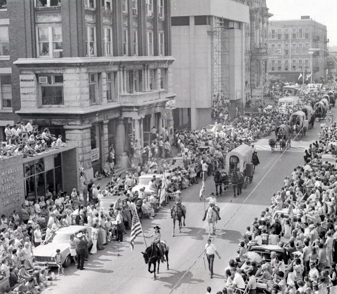 The Zane Trace Commemoration parade is shown making its way down Fourth Street in an undated Times Recorder file photo.