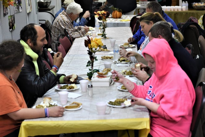People gather at St. Paul AME Church on Pine Street in Zanesville for its annual Thanksgiving dinner on the Saturday before the holiday. The church prepares food for 125 people.