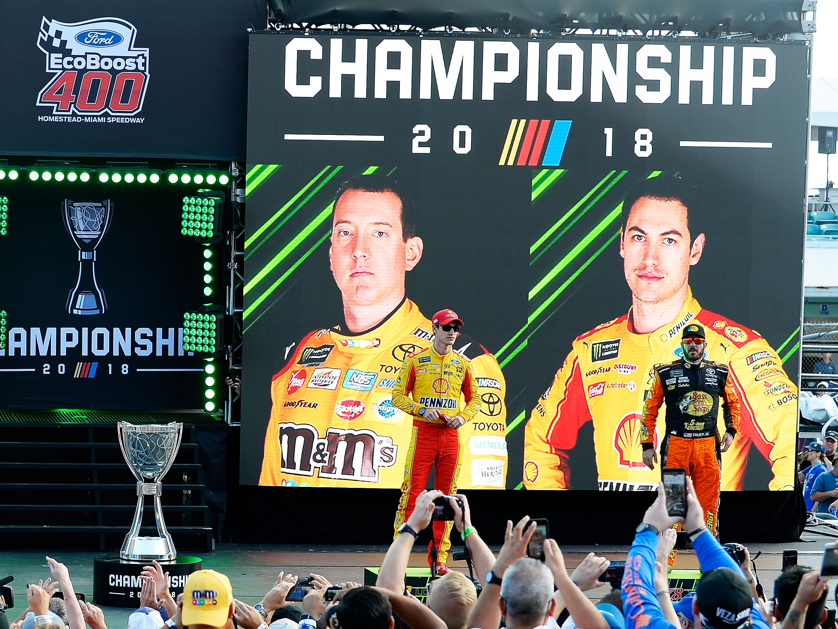 Championship contenders Joey Logano, left, and Martin Truex Jr., right, are introduced to the crowd at Homestead-Miami Speedway.