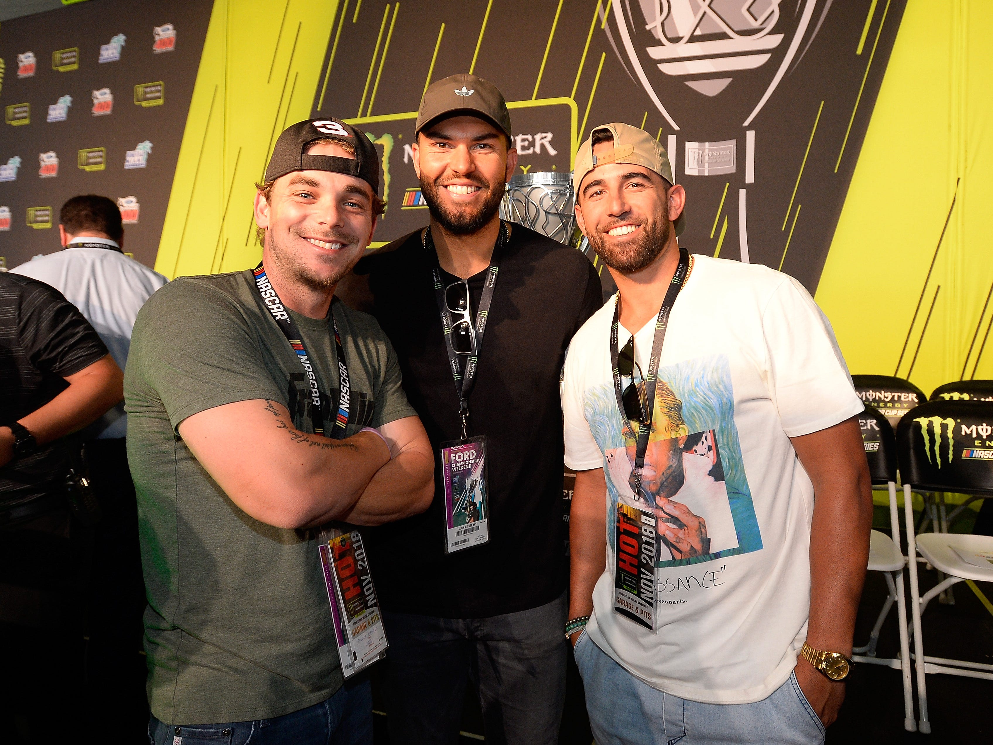 Major League Baseball players Scooter Gennett (left), Eric Hosmer and Deven Marrero attend the driver's meeting prior to the Ford EcoBoost 400 at Homestead-Miami Speedway.