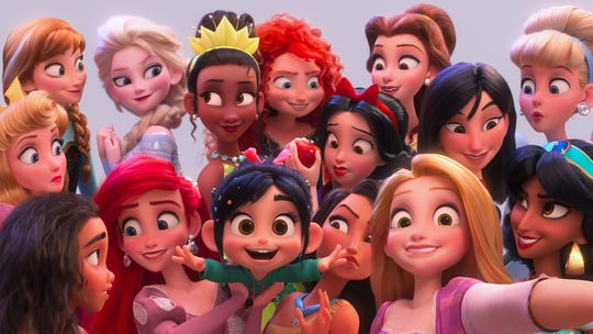 "Vanellope von Schweetz (voiced by Sarah Silverman, center bottom) shares a selfie with her fellow Disney princesses in the sequel ""Ralph Breaks the Internet."""