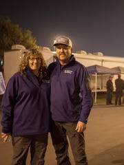 Teresa and James Lamb, owners of All American Tent Emergency Services, work into the evening at the Butte County fairgrounds in Chico during the Camp Fire.