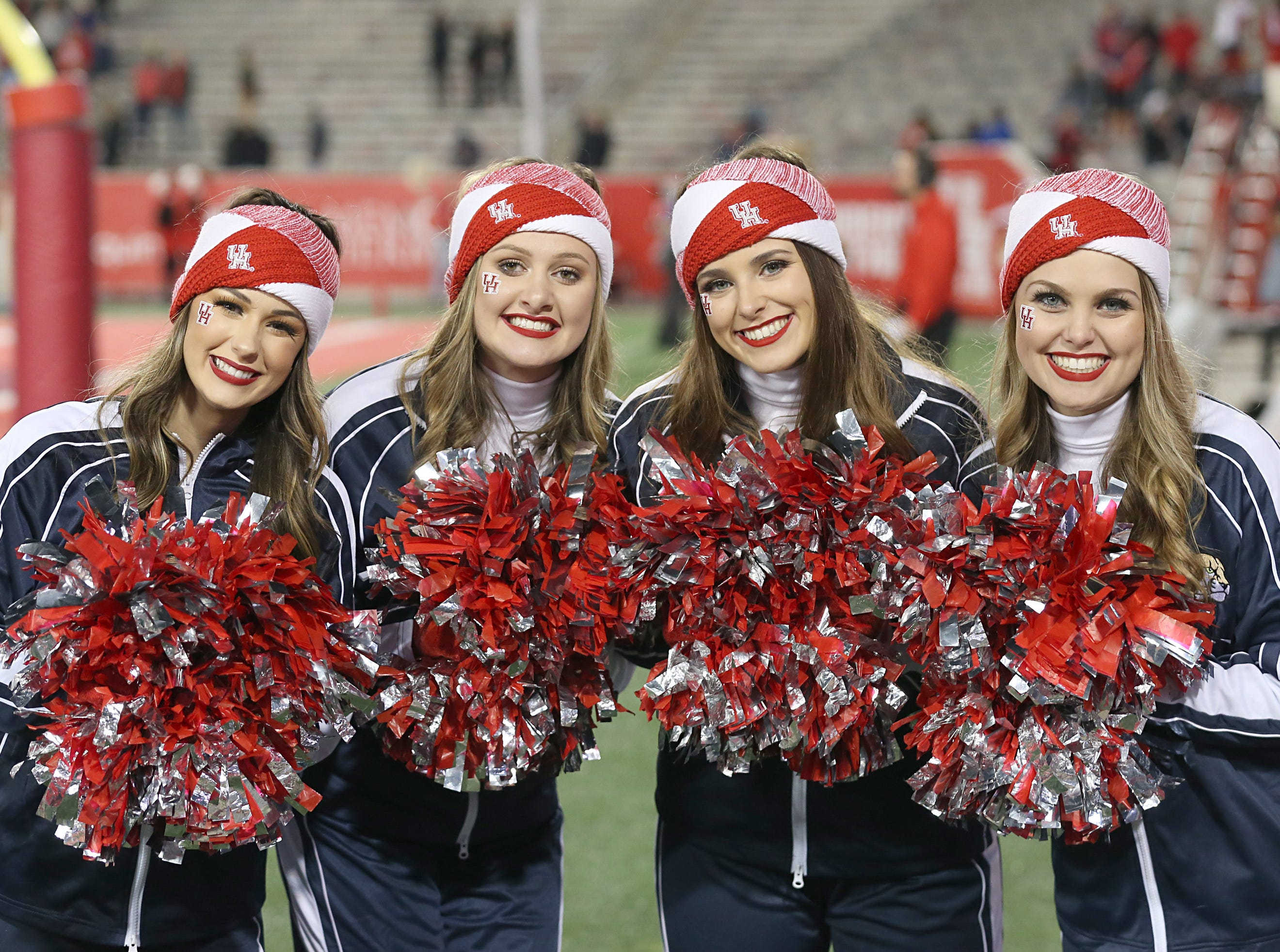 Week 12: Houston Cougars cheerleaders pose for a picture as the Cougars play the Tulane Green Wave in the third quarter at TDECU Stadium.