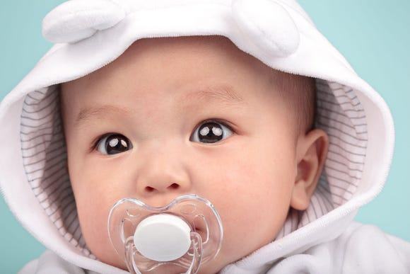 New research suggests that a parent who spit-cleans his or her child's pacifier may help them avoid allergies.