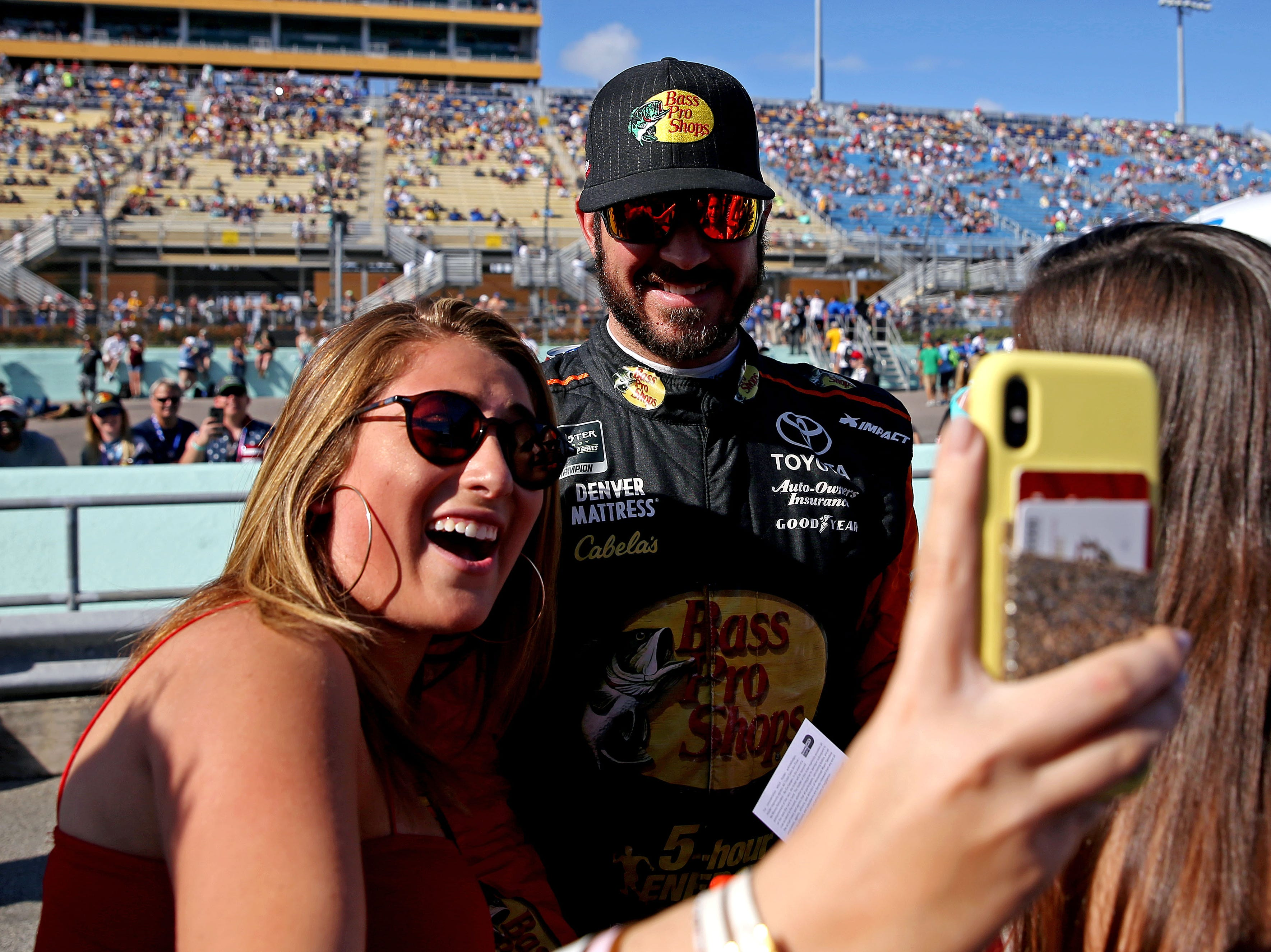 Martin Truex Jr. takes a selfie with a fan before the Ford EcoBoost 400 at Homestead-Miami Speedway.