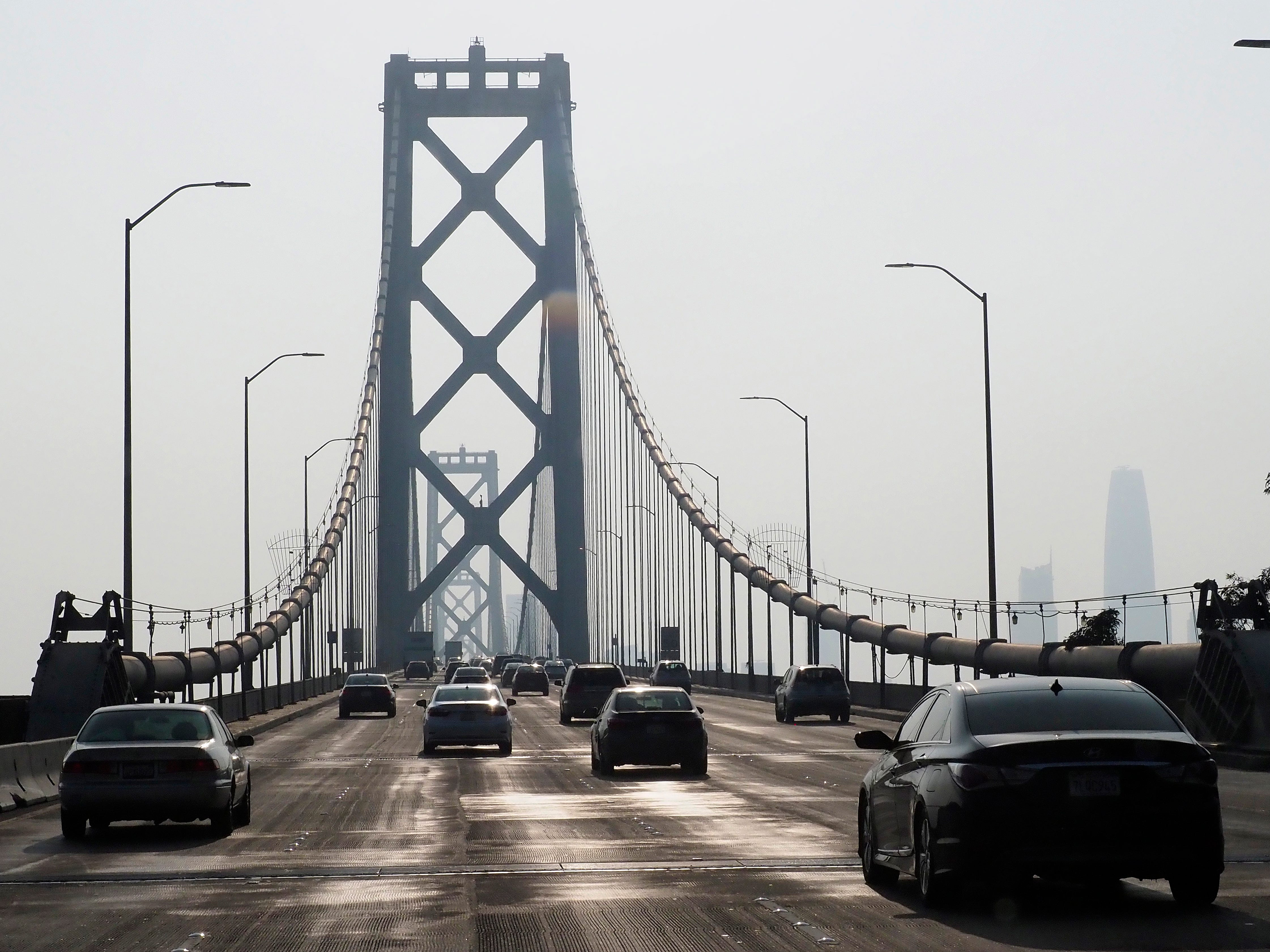Cars drive on the Oakland-San Francisco Bay Bridge in San Francisco, Nov. 17, 2018, as the California wildfires smoke brings the poor air quality to Northern California. According to Purple Air, an air quality monitoring network, the smoke in California is worse than smoggy cities in India and China.