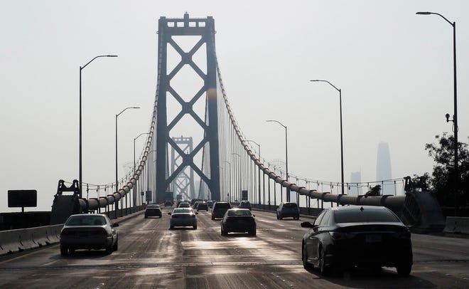 Cars drive on part of the Oakland-San Francisco Bay Bridge in San Francisco, Nov. 17, 2018.