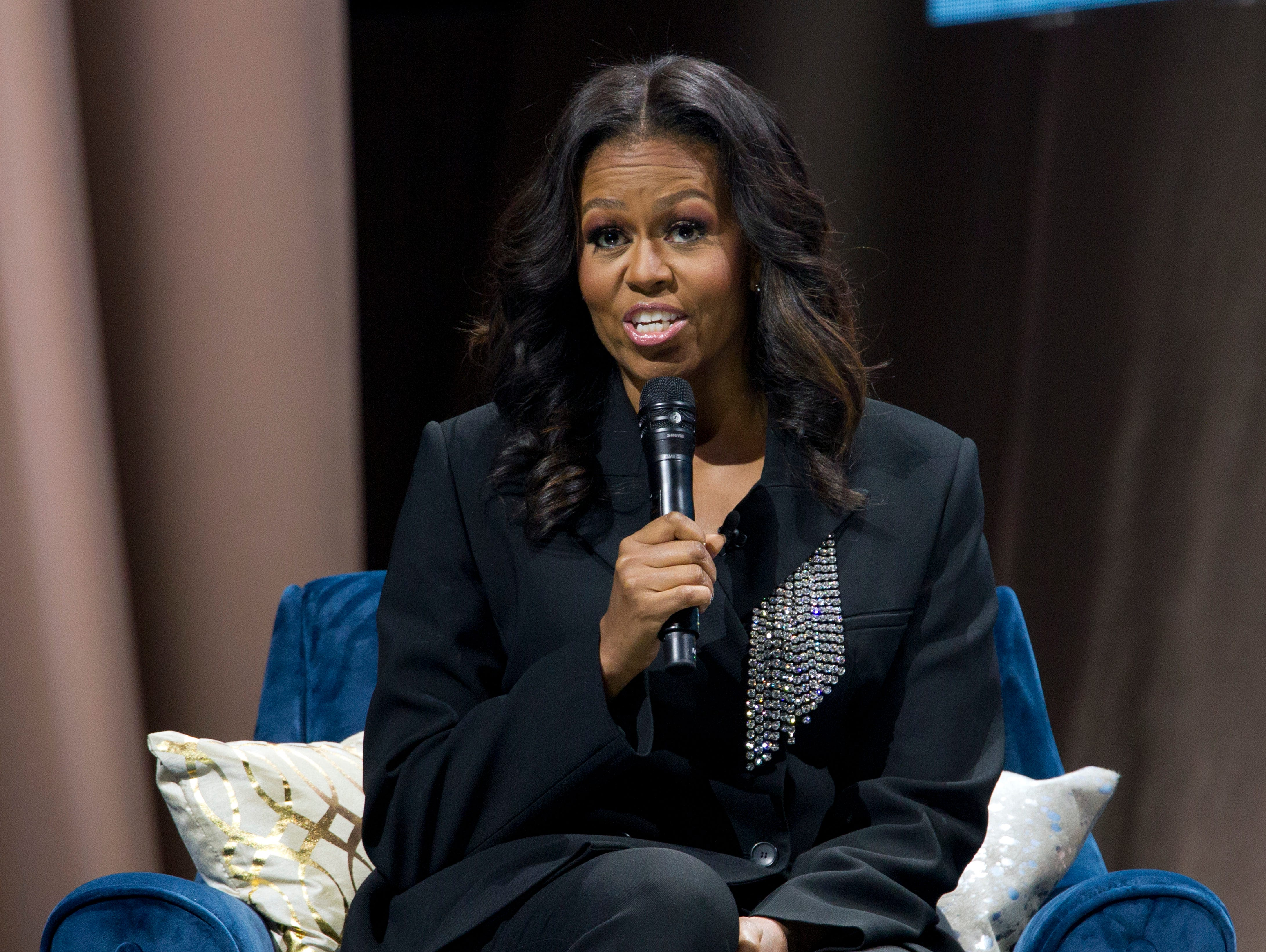 Barack Obama compares himself to Jay-Z during a surprise stop at Michelle's book tour