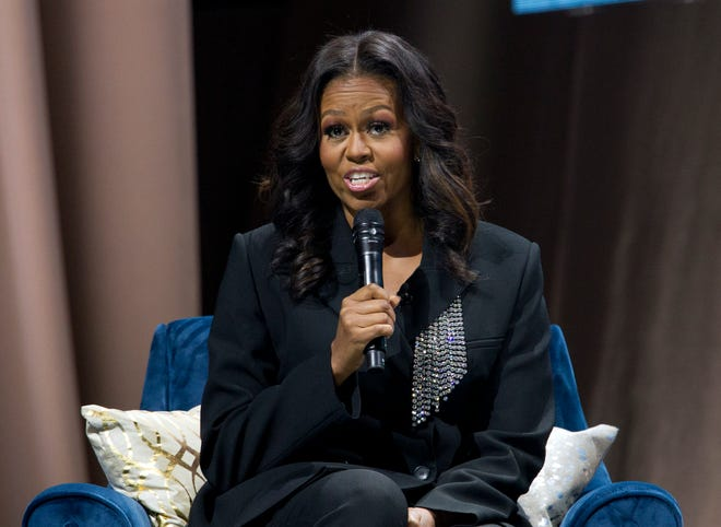 "Former first lady Michelle Obama speaks to the crowd as she presents her anticipated memoir ""Becoming"" during her book tour stop in Washington on Saturday."