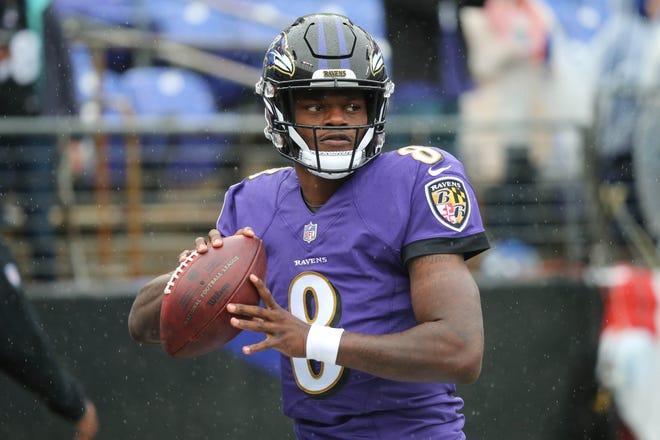 Baltimore Ravens quarterback Lamar Jackson (8) warms up prior to a game against the Denver Broncos at M&T Bank Stadium.