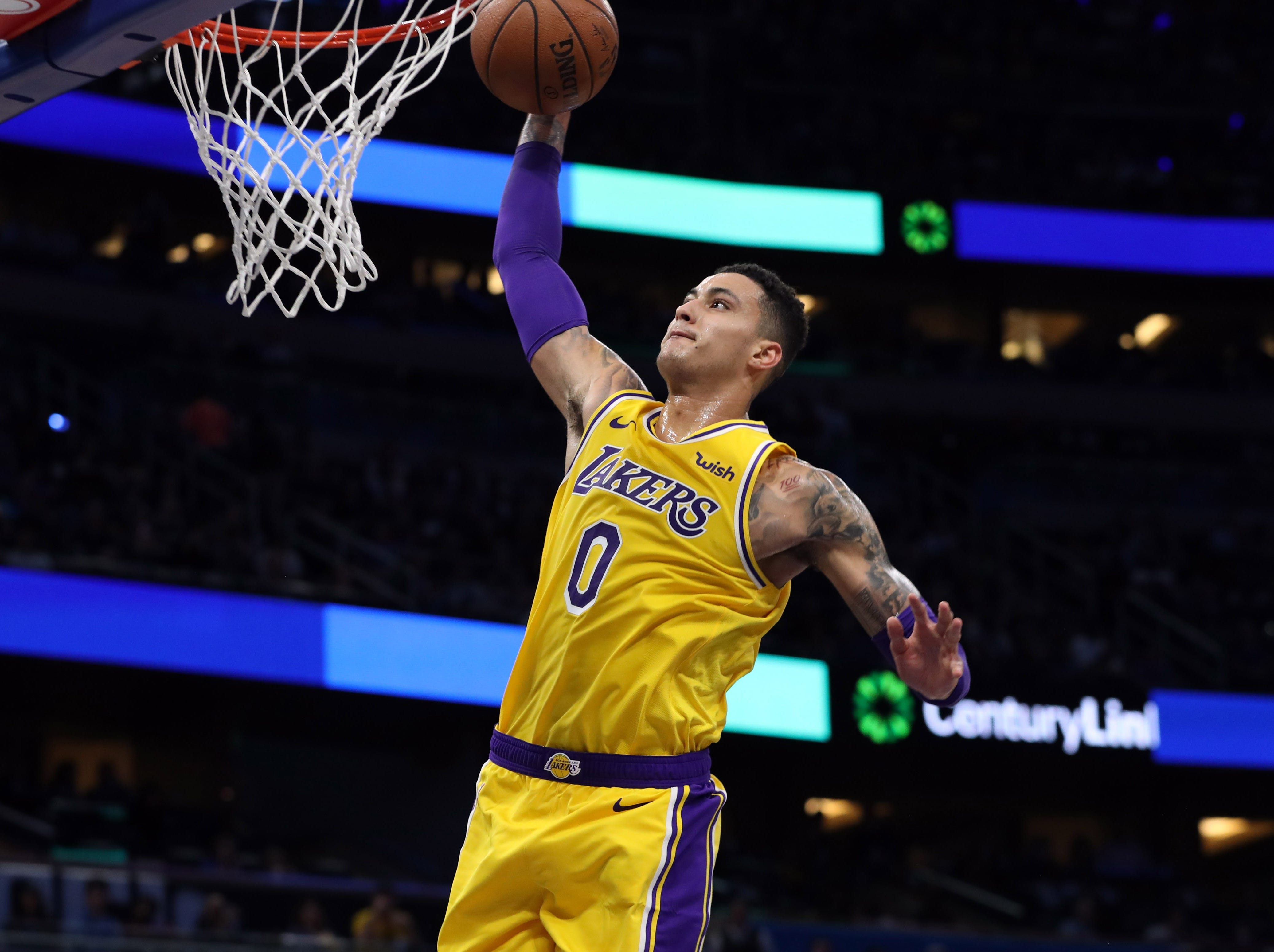 Nov. 17: Lakers forward Kyle Kuzma finishes the fastbreak with a one-handed slam during the first half against the Magic.