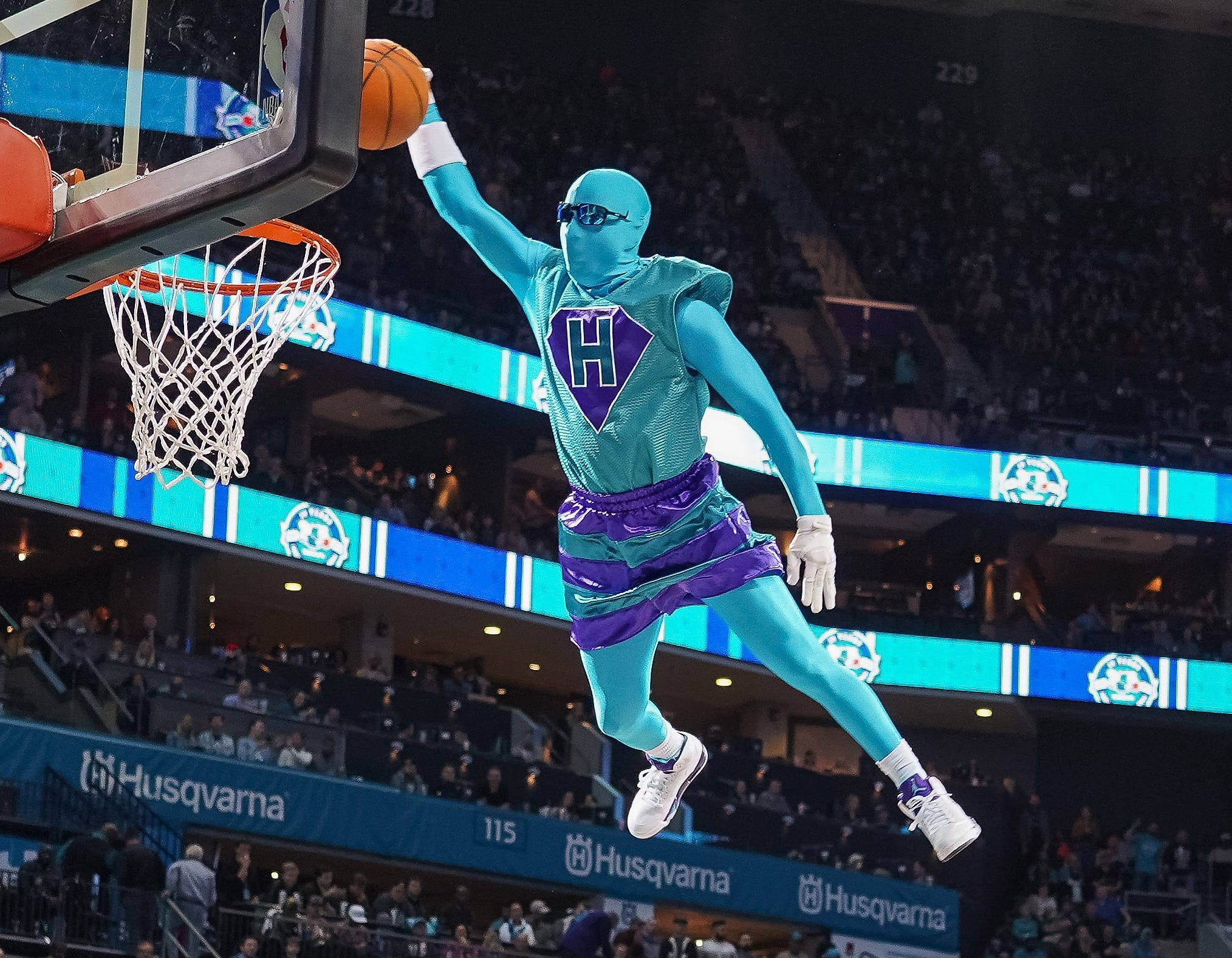 Nov. 17: Hornets mascot Super Hugo soars off a trampoline for a dunk.