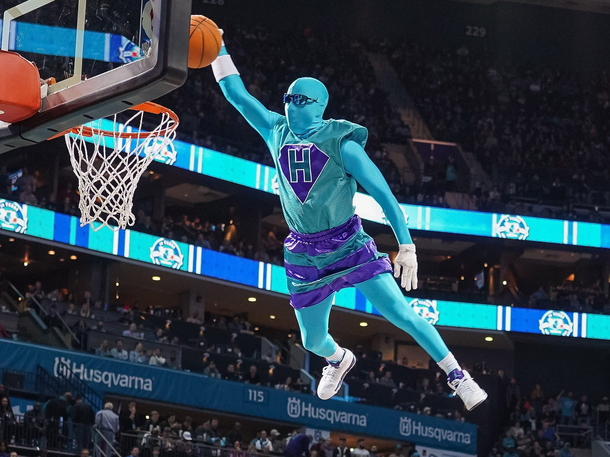 Nov. 17: Hornets mascot Super Hugo soars off a trampoline for a dunk.