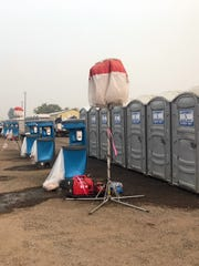 California contracts with private businesses to supply portable toilets for wildland firefighters. This setup is at the Butte County fairgrounds in Chico for the November 2018 Camp Fire.