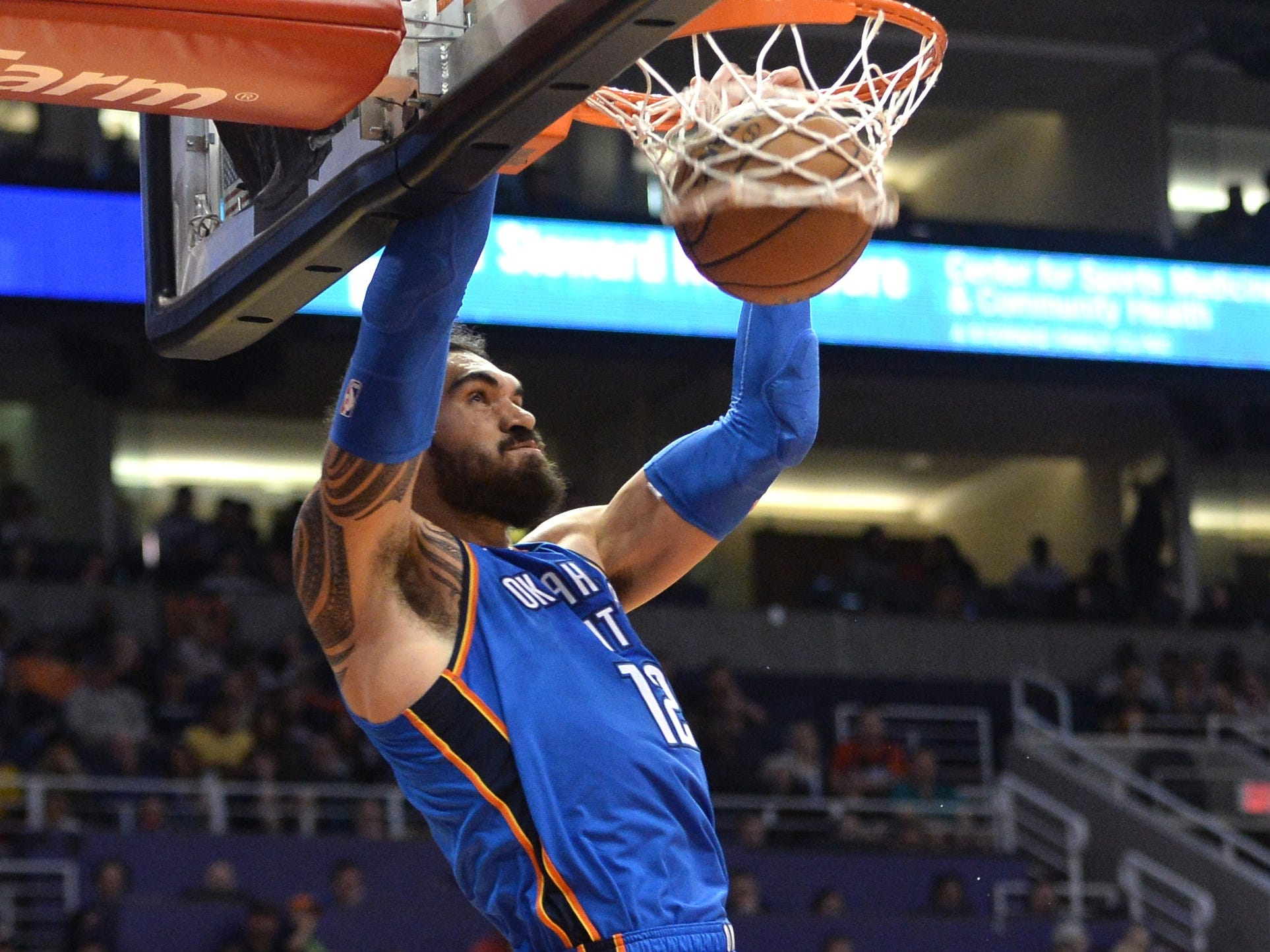 Nov. 17: Thunder center Steven Adams finishes with authority during the second half against the Suns.