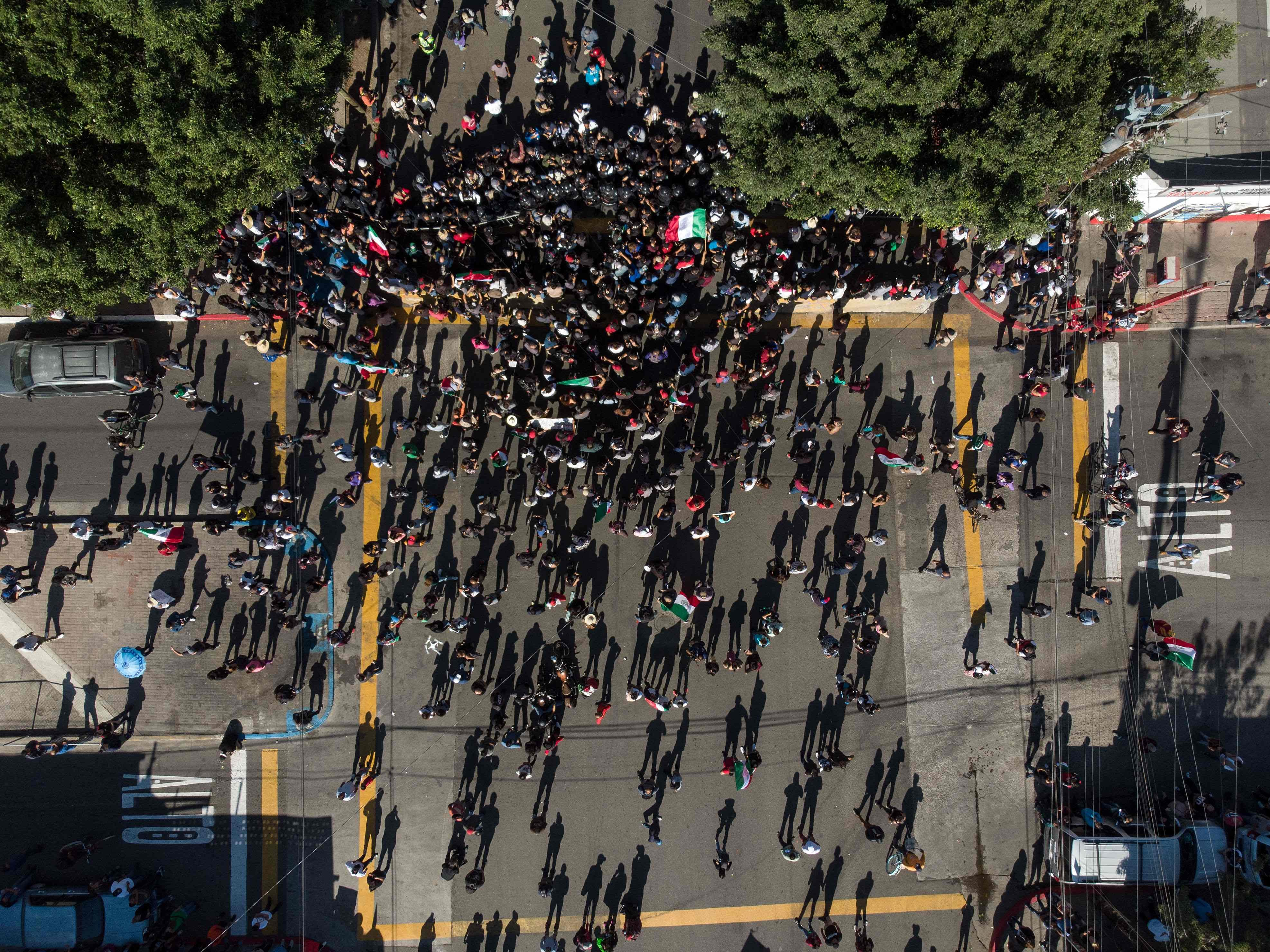 Aerial view of people demonstrating against the Central American migrants in Tijuana, blocked by riot police near a temporary shelter, on Nov. 18, 2018, in Tijuana, Mexico.
