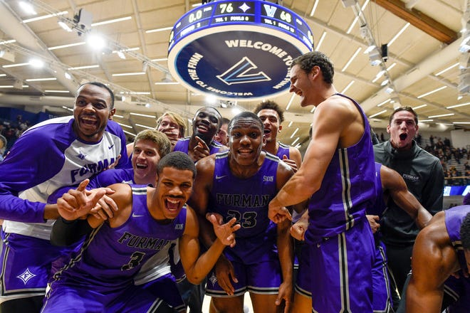 The Furman Paladins celebrate after a victory against the Villanova Wildcats at Finneran Pavilion.