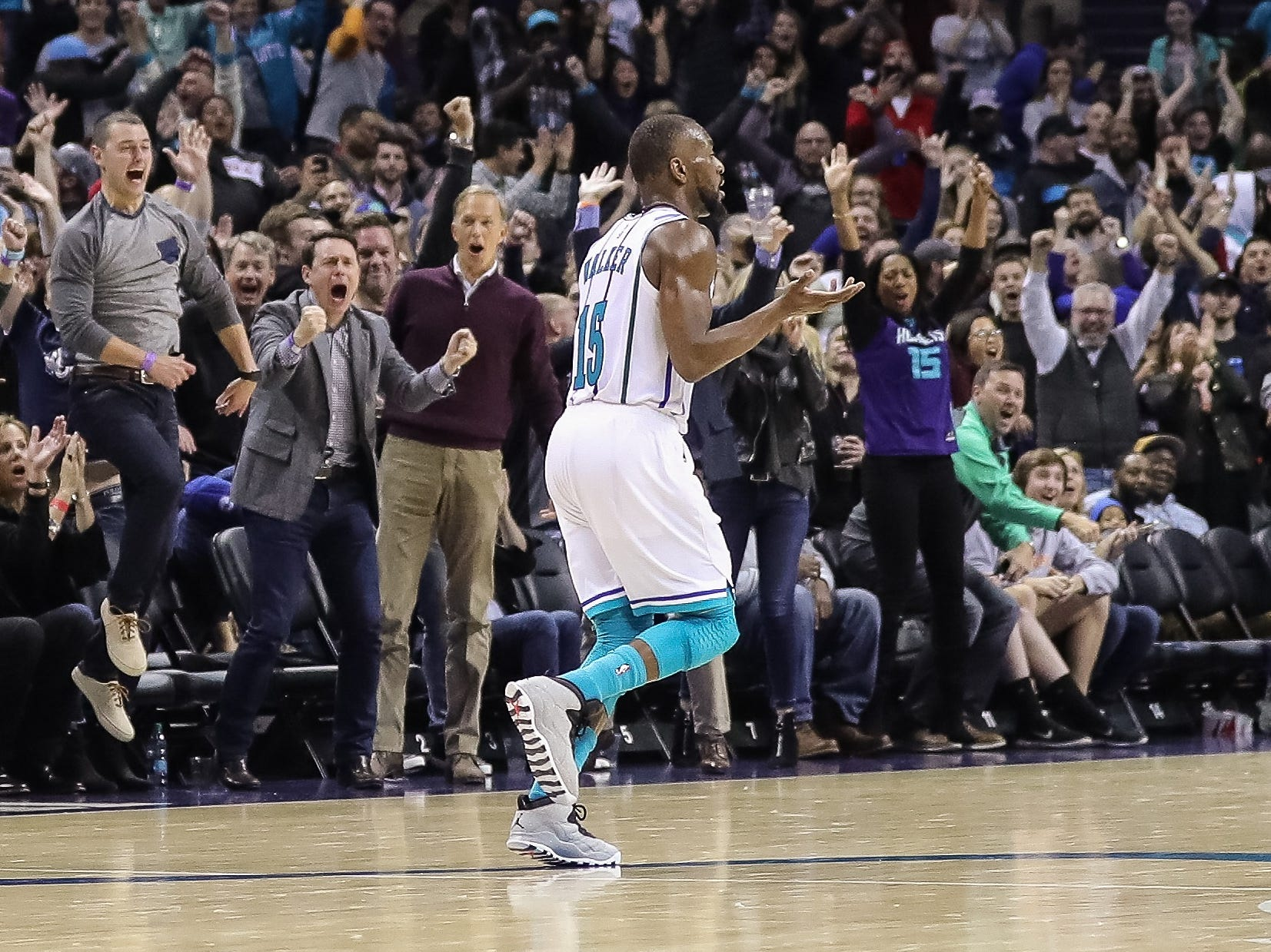 Nov. 17: Hornets guard Kemba Walker celebrates a big bucket late in the second half against the 76ers in Charlotte. Walker poured in a franchise-record 60 points on the night.