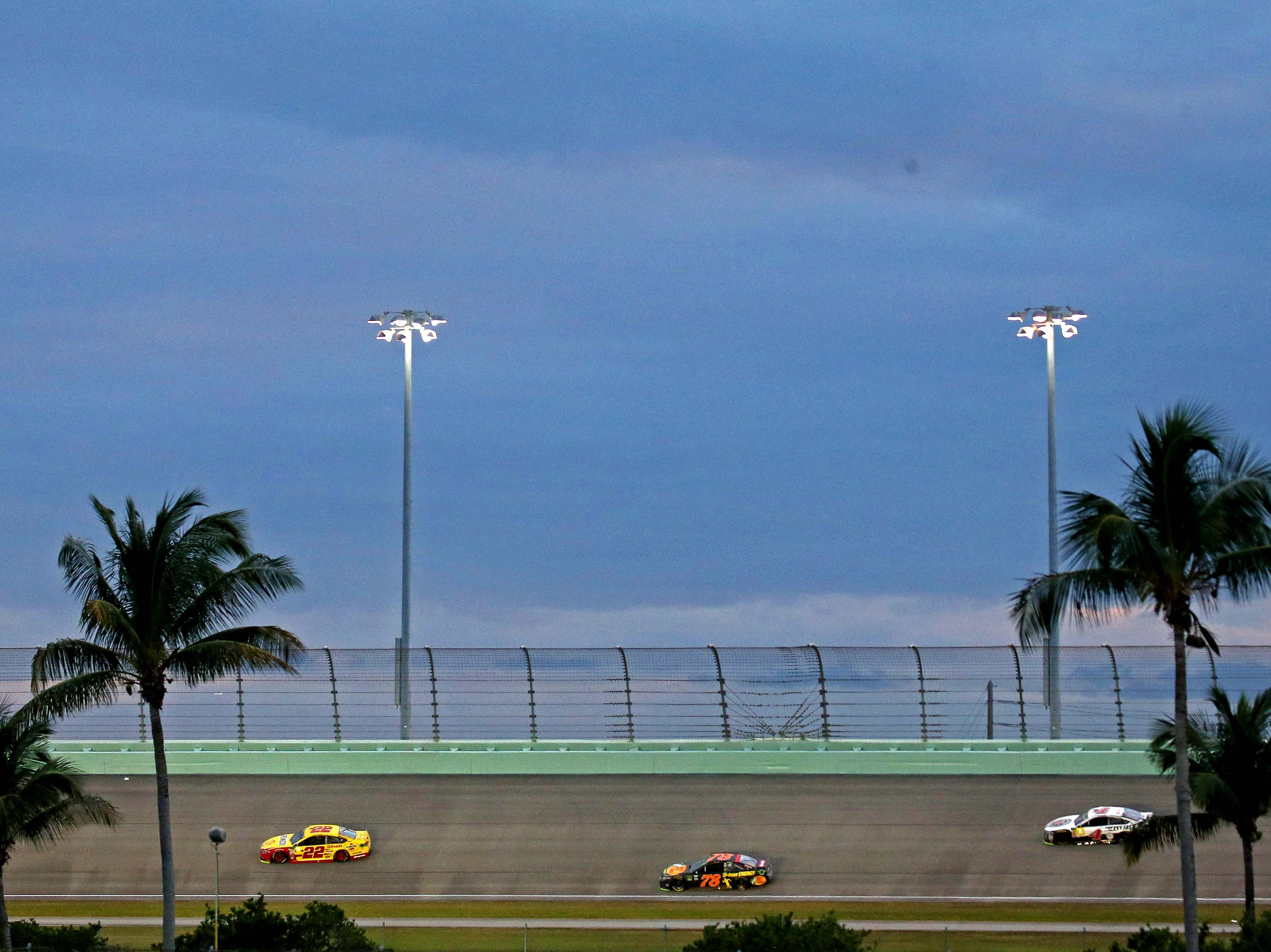 Championship contenders Joey Logano (22), Martin Truex Jr. (78) and Kevin Harvick run 1-2-3 during the Ford EcoBoost 400 at Homestead-Miami Speedway.