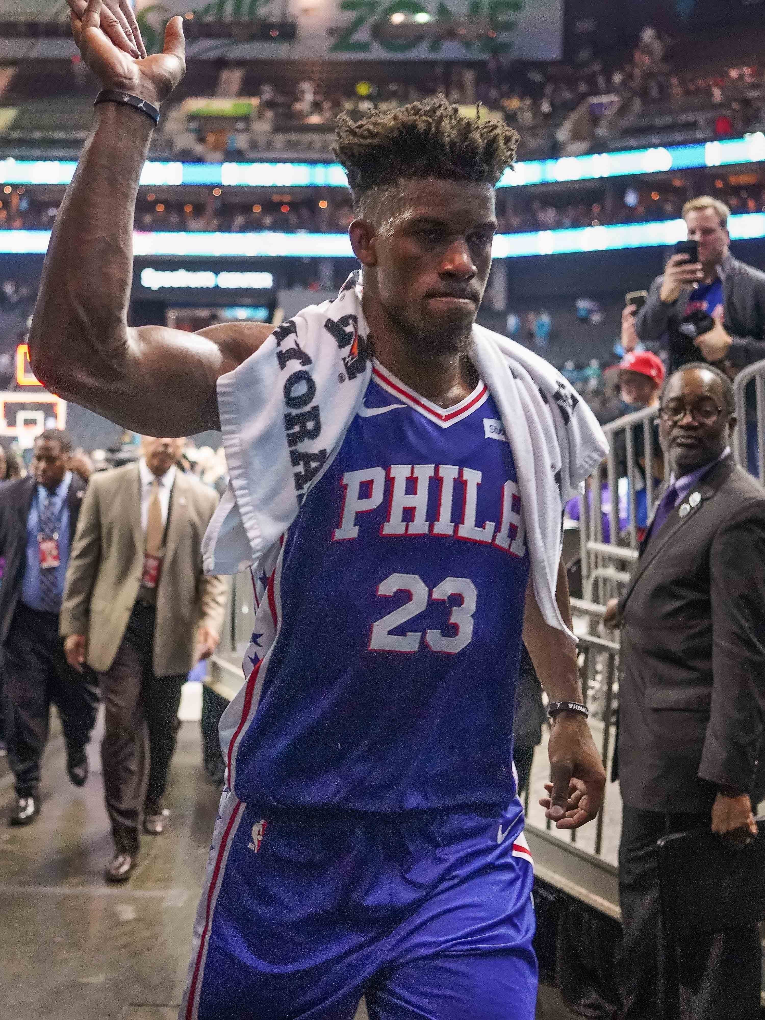 Jimmy Butler triumphantly leaves the floor after his late-game heroics sealed a 76ers win.