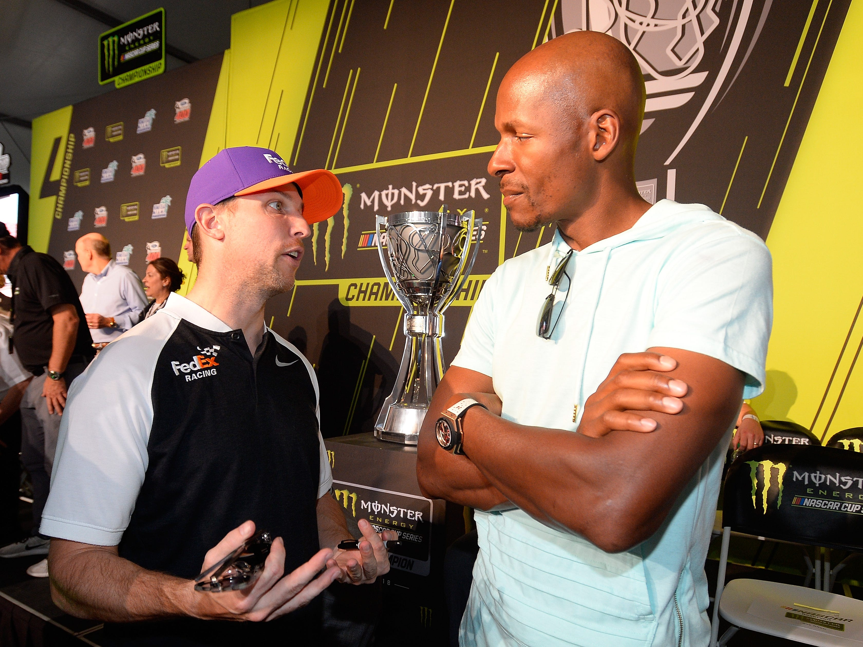Pole winner Denny Hamlin, left, talks to NBA Hall or Famer Ray Allen at the driver's meeting prior to Ford EcoBoost 400.