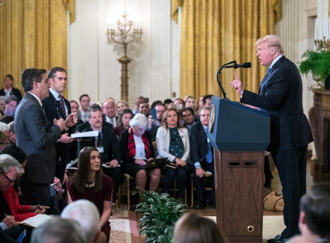 President Donald Trump and Jim Acosta, left, in the White House on Nov. 7, 2018.