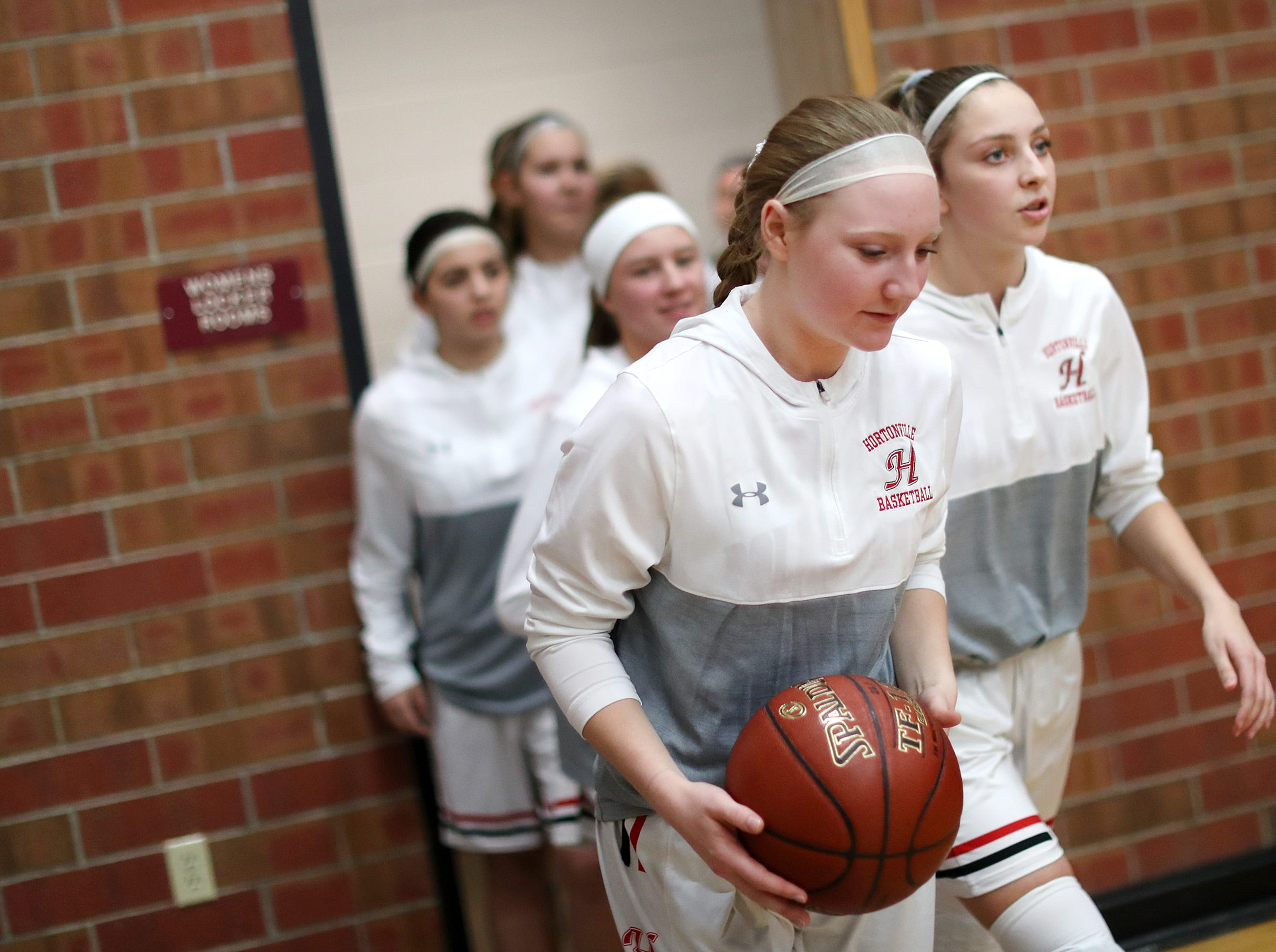 Hortonville High School's Morgan Draheim takes to the court before their game against Marshfield High School Thursday, Nov. 15, 2018, in Hortonville, Wis.