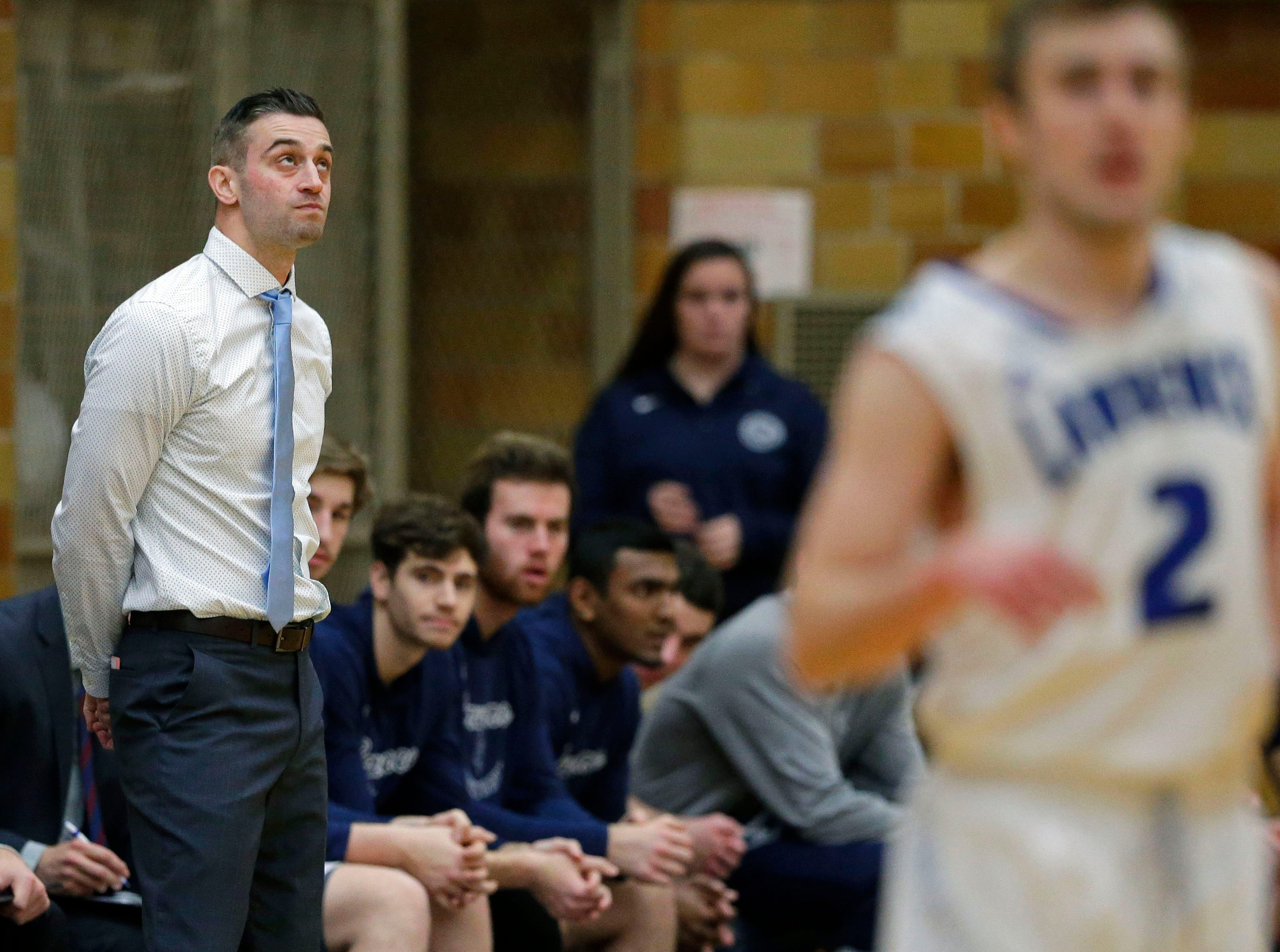 Lawrence University coach Zach Filzen glances at the scoreboard as the Vikings take on MSOE Saturday, November 17, 2018, at Alexander Gym in Appleton, Wis.