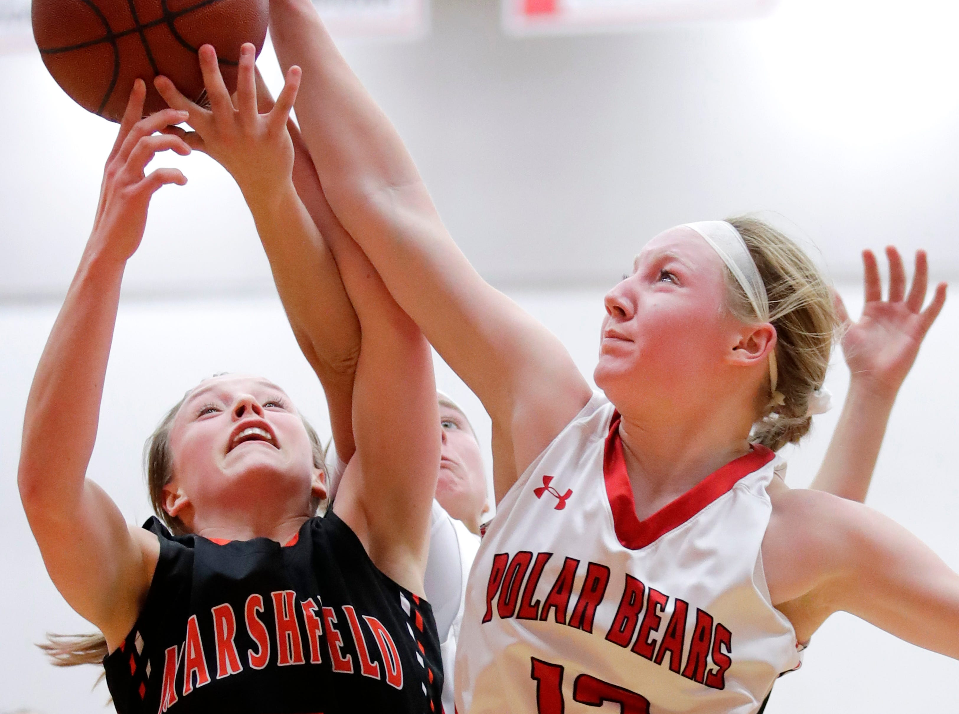 Marshfield High School's Kaydee Johnson can't get a shot past Hortonville High School's Morgan Draheim Thursday, Nov. 15, 2018, in Hortonville, Wis.