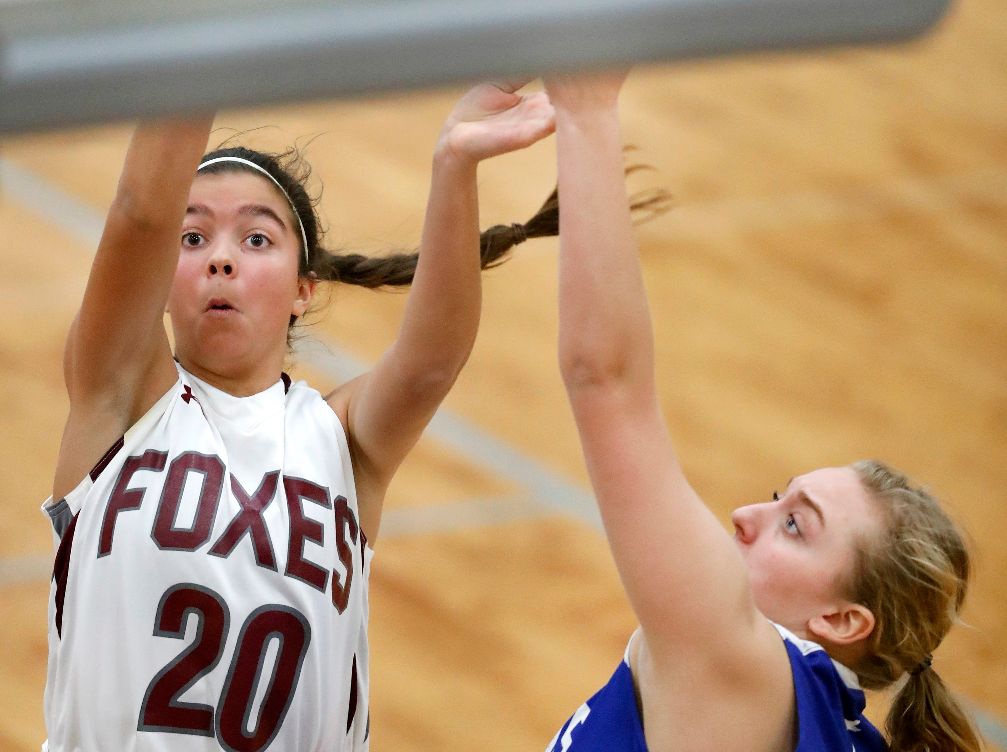 Fox Valley Lutheran High School's Maddie Jacobsen takes a shot against Winnebago Lutheran Academy Tuesday, Nov. 13, 2018, in Appleton, Wis. Fox Valley Lutheran High School lost to Winnebago Lutheran Academy 48-38.