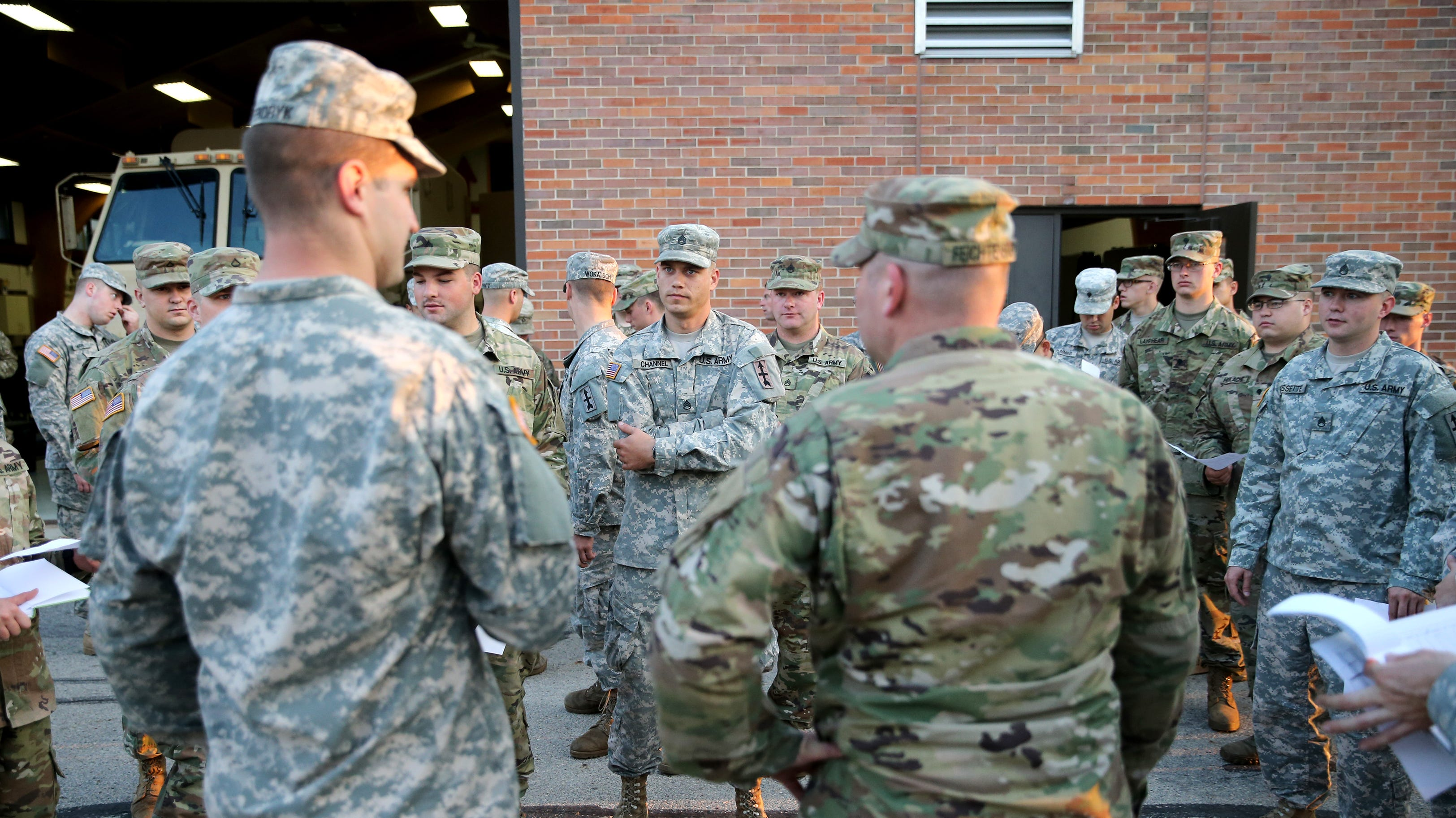Members of the Headquarters and Headquarters Company, 2nd battalion, 127th Infantry, of the Wisconsin National Guard gather for a convoy briefing before deployment to Florida to support Hurricane Irma relief efforts Tuesday, Sept. 12, 2017, in Appleton, Wis.